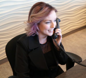 South Calgary Orthodontist | McKenzie Orthodontics | Friendly Receptionist Answering Phone