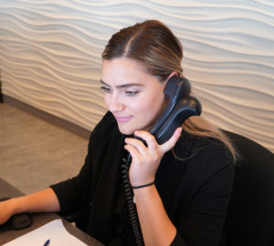 South Calgary Orthodontist | McKenzie Orthodontics | Receptionist Answering Phone