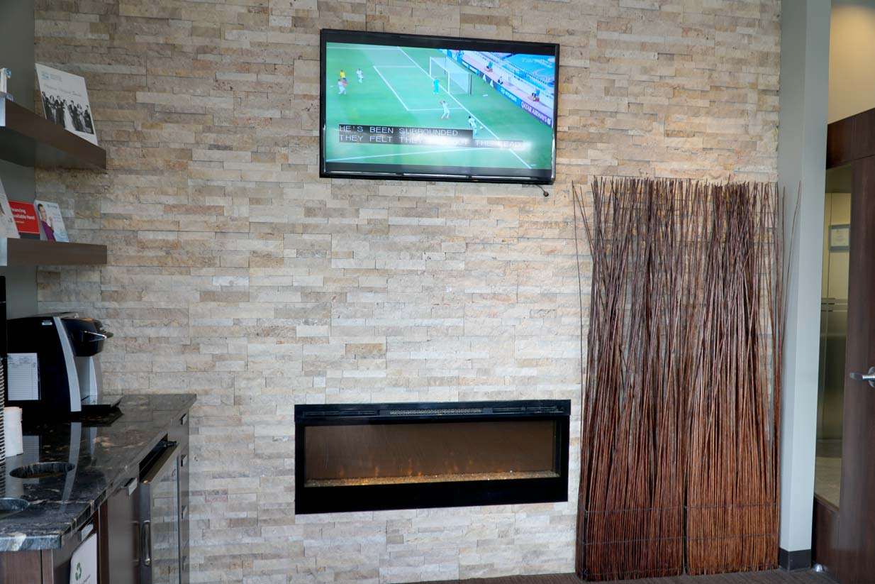 South Calgary Orthodontist | McKenzie Orthodontics Fireplace & TV